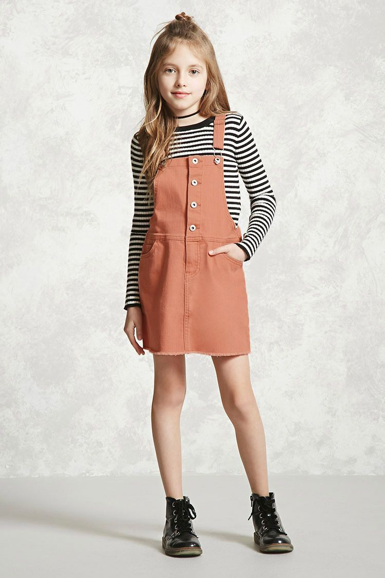 bf4e80a483d181 Forever 21 Girls - A denim overall dress featuring a frayed hem, a buttoned  front placket, a five-pocket construction, and adjustable straps.