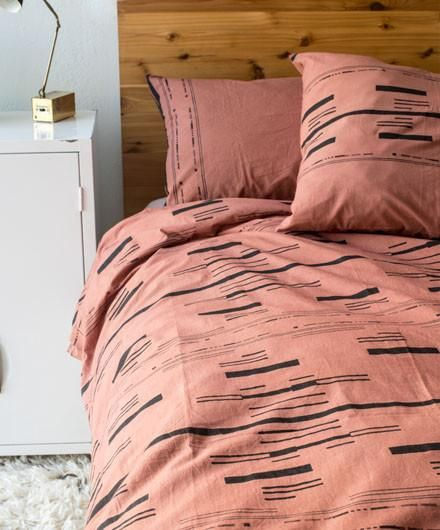 <p>Beautiful, simple and understated, this bedding set features a delicate dusty rose tone with contrasting geometric patterns artfully handblock printed...