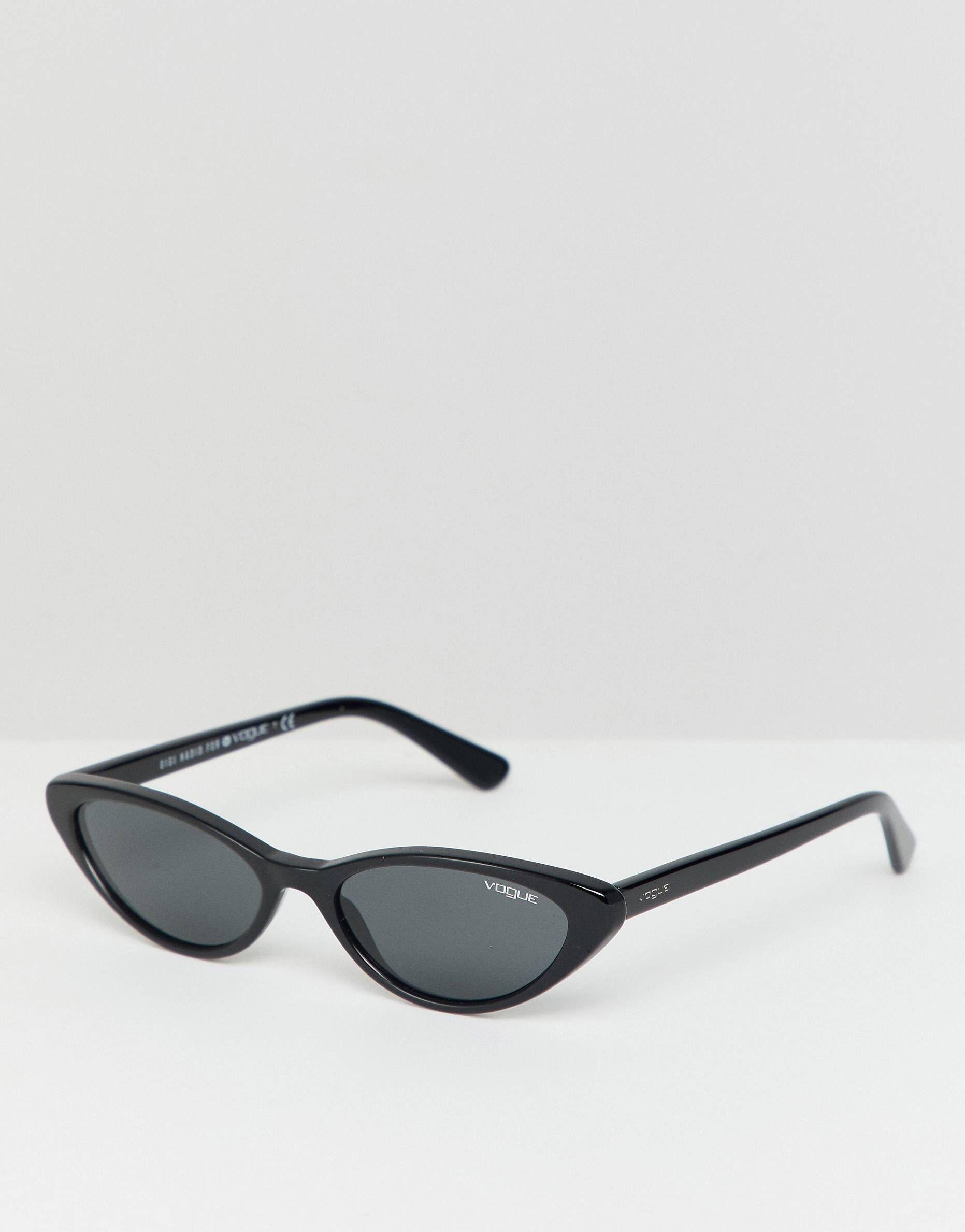 69b9782b99338 Vogue Eyewear 0VO5237S cat eye slim frame sunglasses in black by Gigi Hadid