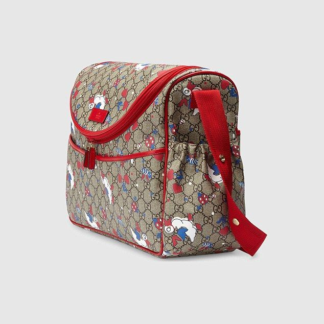 ca70bf22d7ed BAG OF TRICKS — £1,050 Gucci canvas baby changing bag from selfridges.com