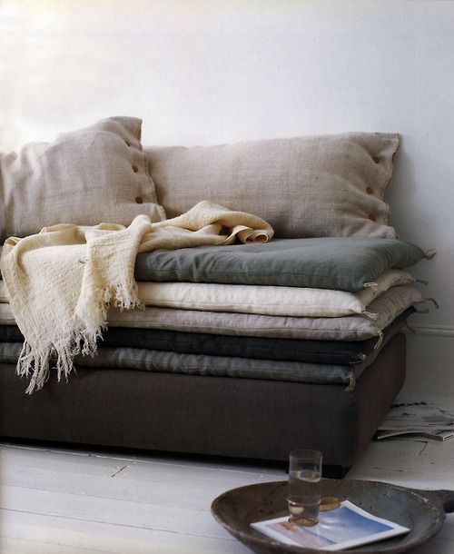 Black Leather Sofa Or Base Pilled High With Oversized Fluffy Pillows And  Down Mattress Tops,