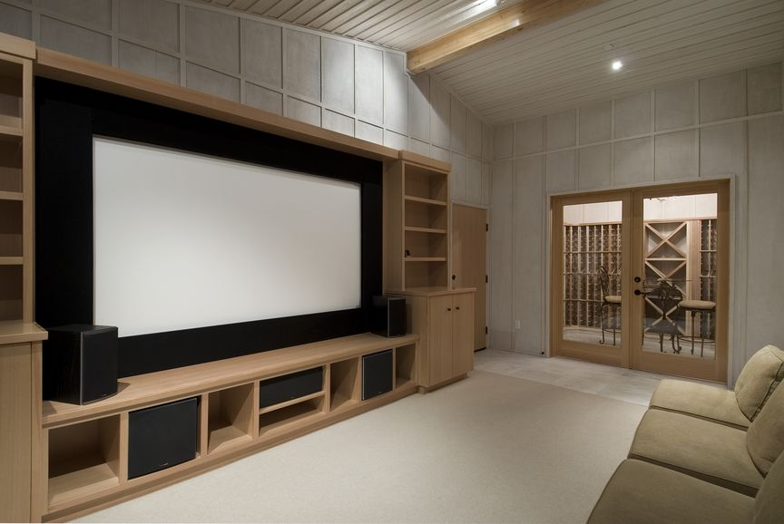 Picture Of Cozy And Simple Home Entertainment Room Possible Diy Paint Wall Black Or Plywood Behind Screen Between The 2 Bookcase Shelves
