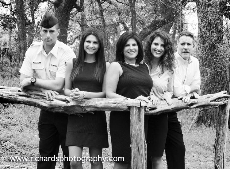 Family portrait of 5 people in black and white portraits taken in san antonio park setting father mother son and two daughters