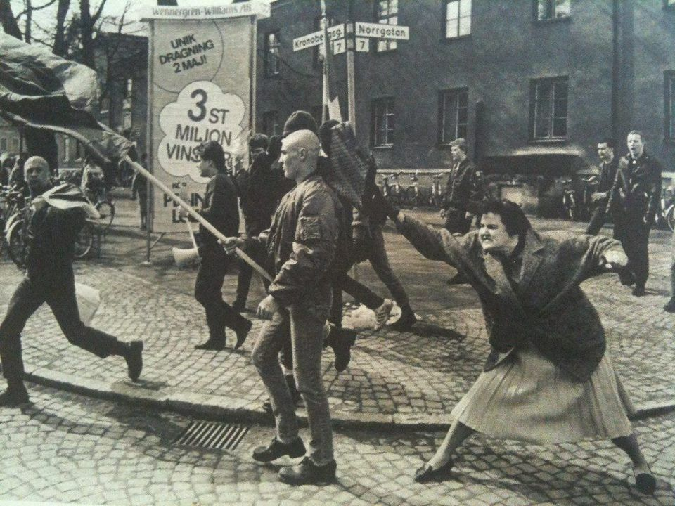 sonounsoffione:  A woman hitting a neo-nazi with her handbag, Sweden, 1985. The woman was reportedly a concentration camp survivor.