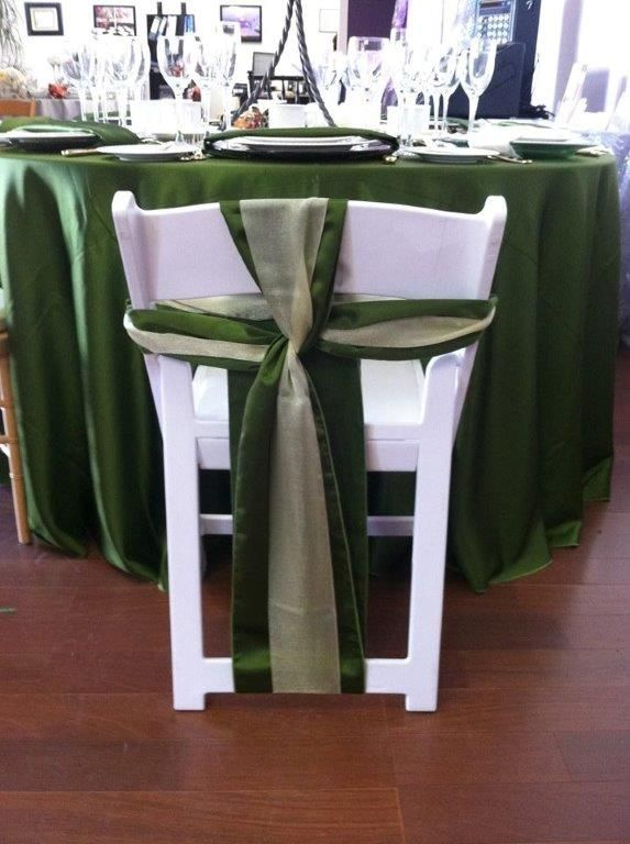 folding chair sashes used stackable chairs cross sash on a white with olive satin gold organza in the center