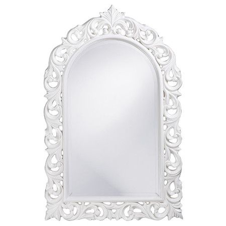 Wall mirror with a scrolling frame in glossy white.      Product: MirrorConstruction Material: Resin and mirrored...