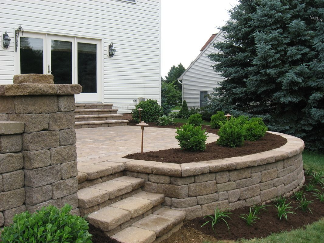 paver patios with lighting raised patio seat wall landscape planting and landscape - Patio Paver Design Ideas