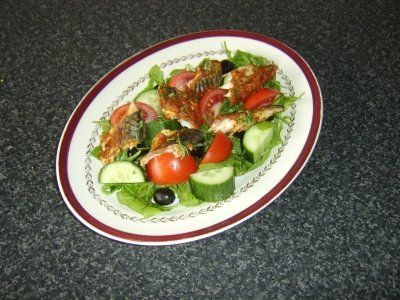 Mackerel baked in red pesto sauce and served with Mediterranean style salad