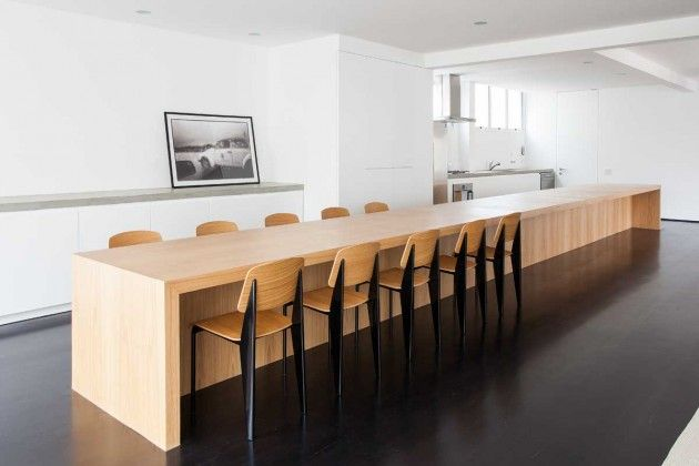 A huge kitchen island/dining table takes center stage in this ...