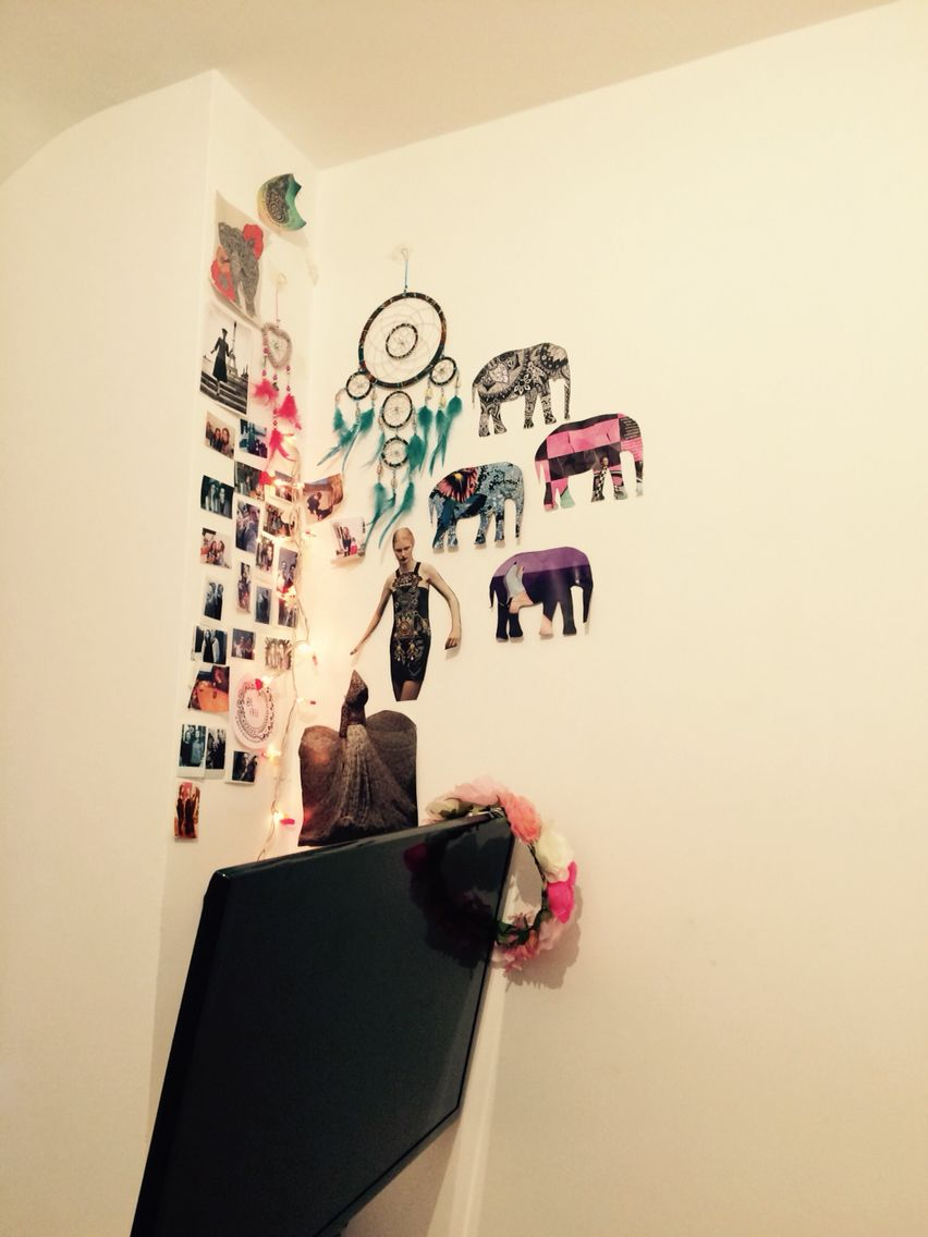 Thought my wall looked pretty with the elephants I cut out of old magazines and my Polaroids on the other side along with some boho dream catchers