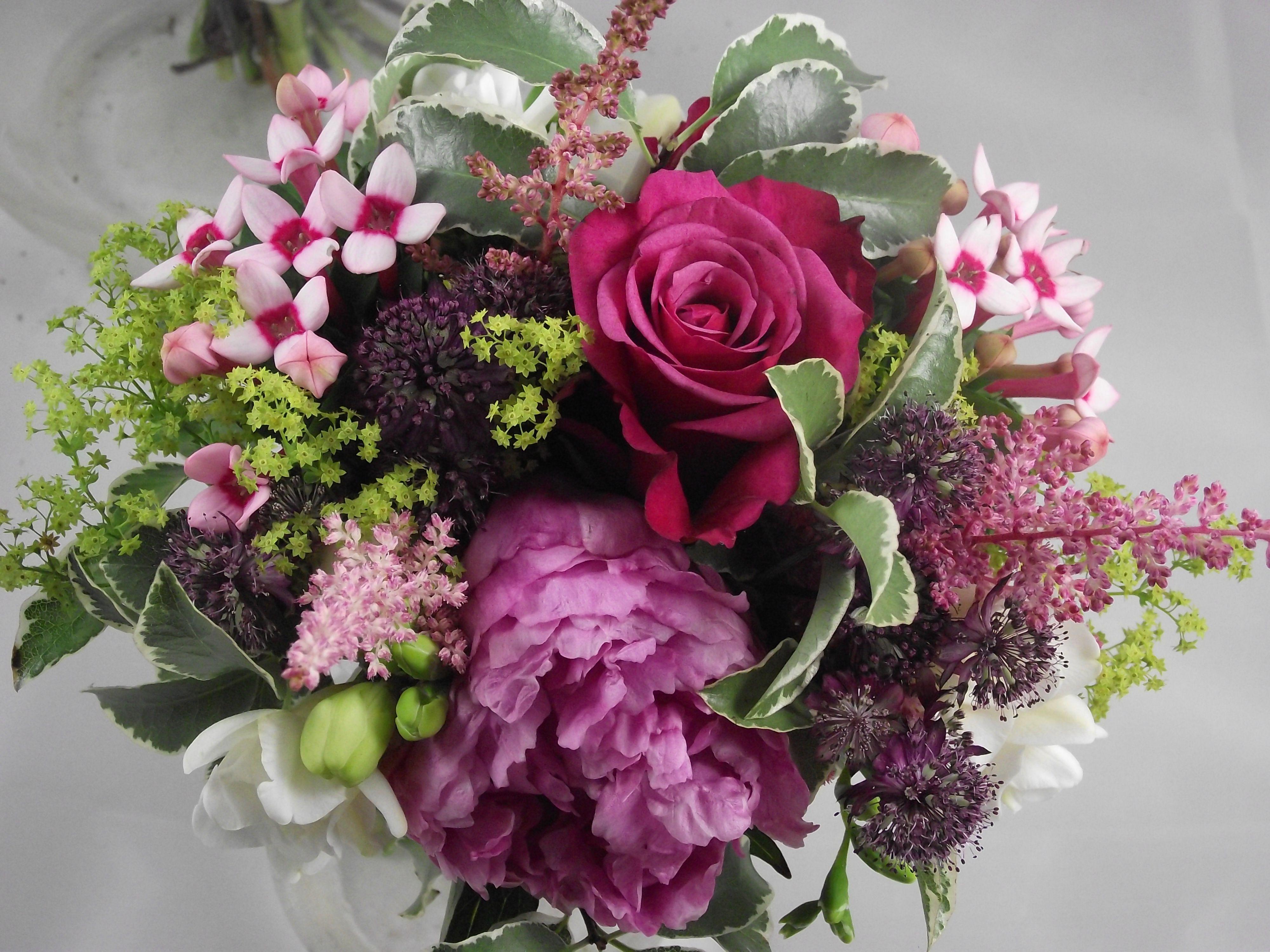 Deep fushia coloured roses, pink peonies, pink bouvardia astrantia ...