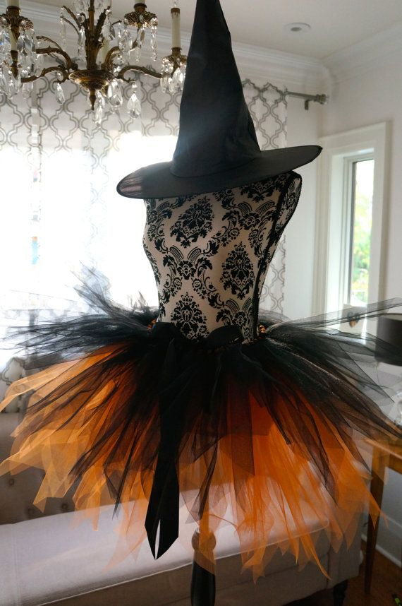 4e5645b5c1 This beautiful handmade adult halloween tutu is made with lots and lots of  gorgeous tulle and ribbon. It is very adjustable and will fit most.