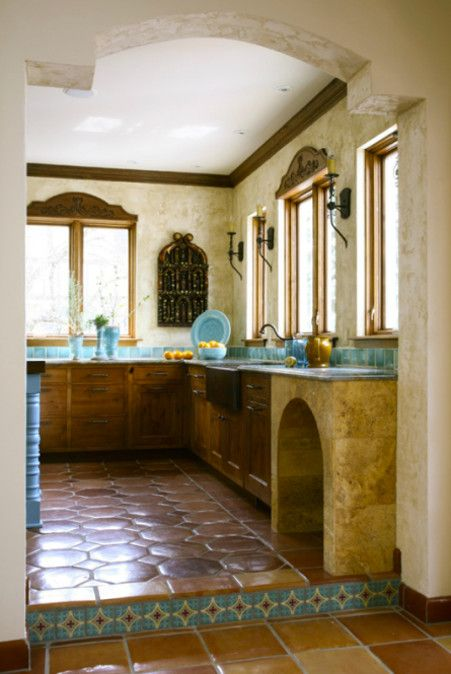 detail of saltillo tile floor and lower cabinets in turquoise tile ...