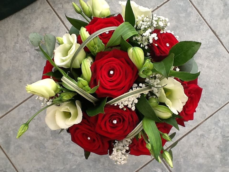 Classic looking bouquet with red roses, white lisianthus, gyp and