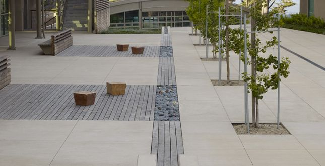 Storm water feature in a gathering space site elements for Outer space design landscape architects