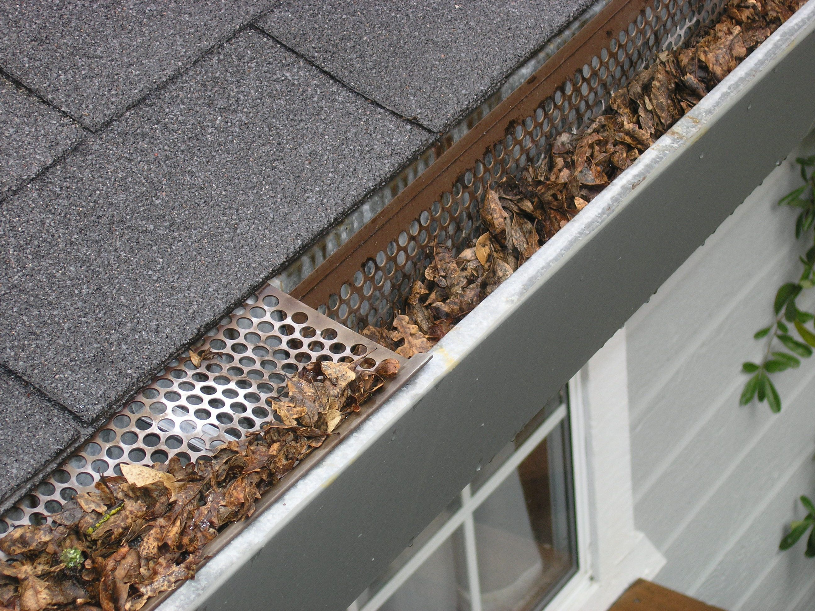 Does This Picture Resemble Your Clogged Gutters This Is The Problem With Inexpensive Plastic And Cleaning Gutters Home Maintenance Home Maintenance Checklist