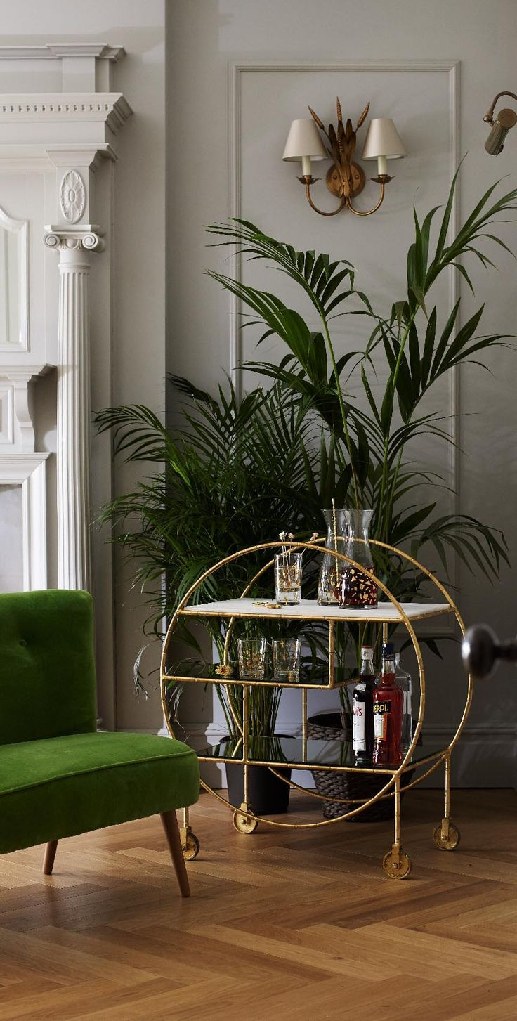 With a mixture of marble and burnished mirrored shelves and