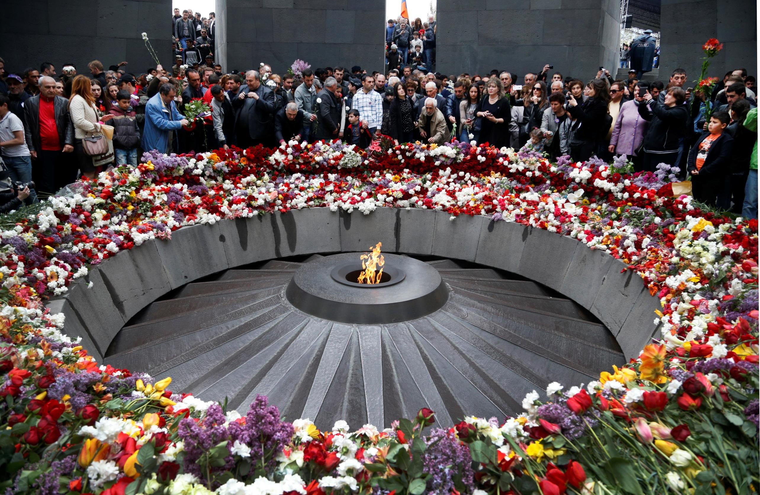 People lay flowers at a memorial to Armenians killed by the Ottoman Turks, as they mark the centenar... - AP Photo/Sergei Grits
