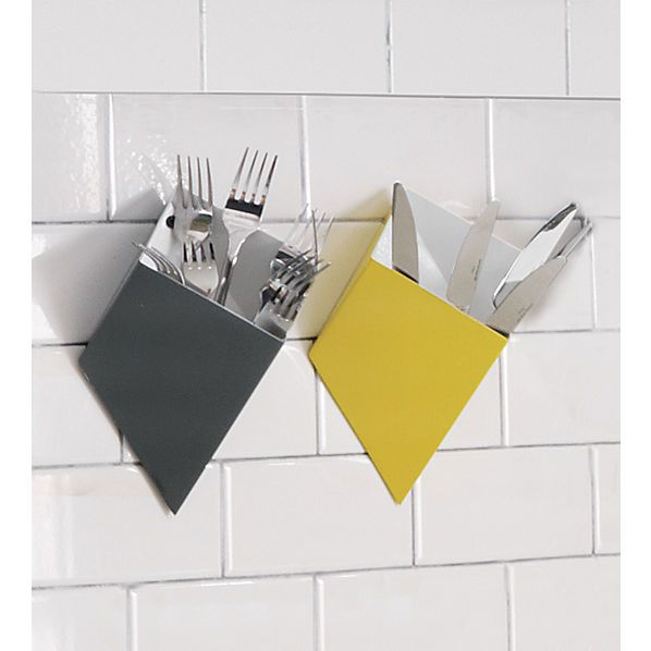 wall pockets | CB2 - stash remotes. Could be attached to rolling ...