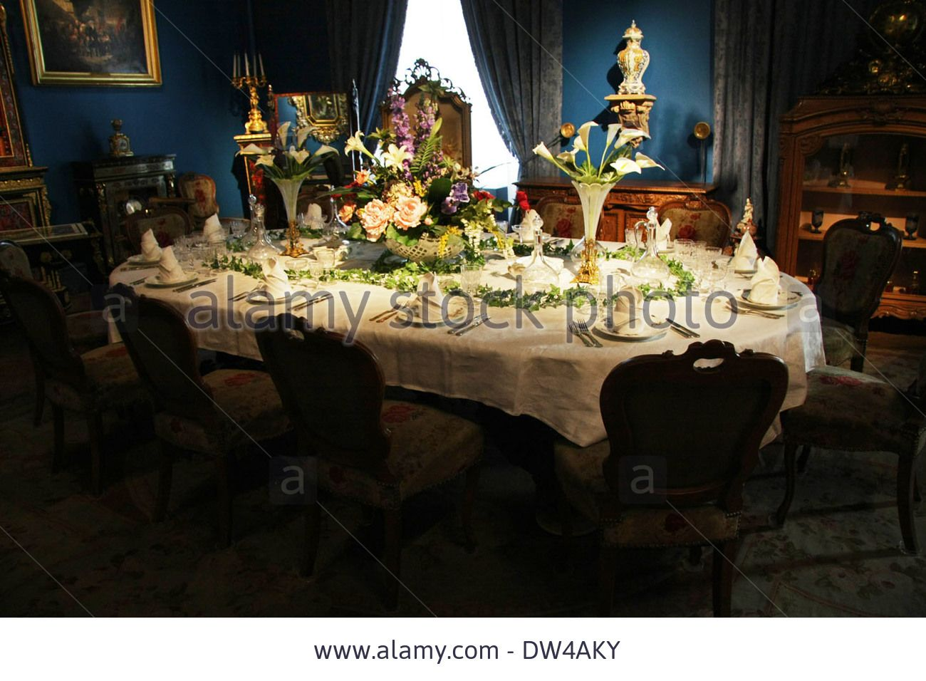 Victorian dining table setting, silver service place settings in a dining  room Stock Photo Victorian