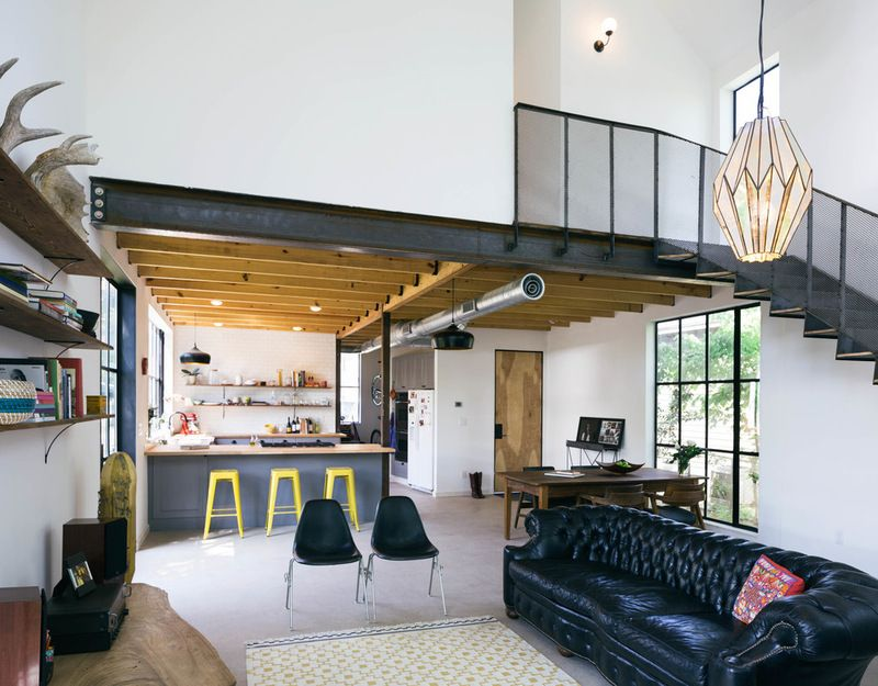 Industrial Living Room by PAVONETTI Office of Design.  Love the openness and steel.