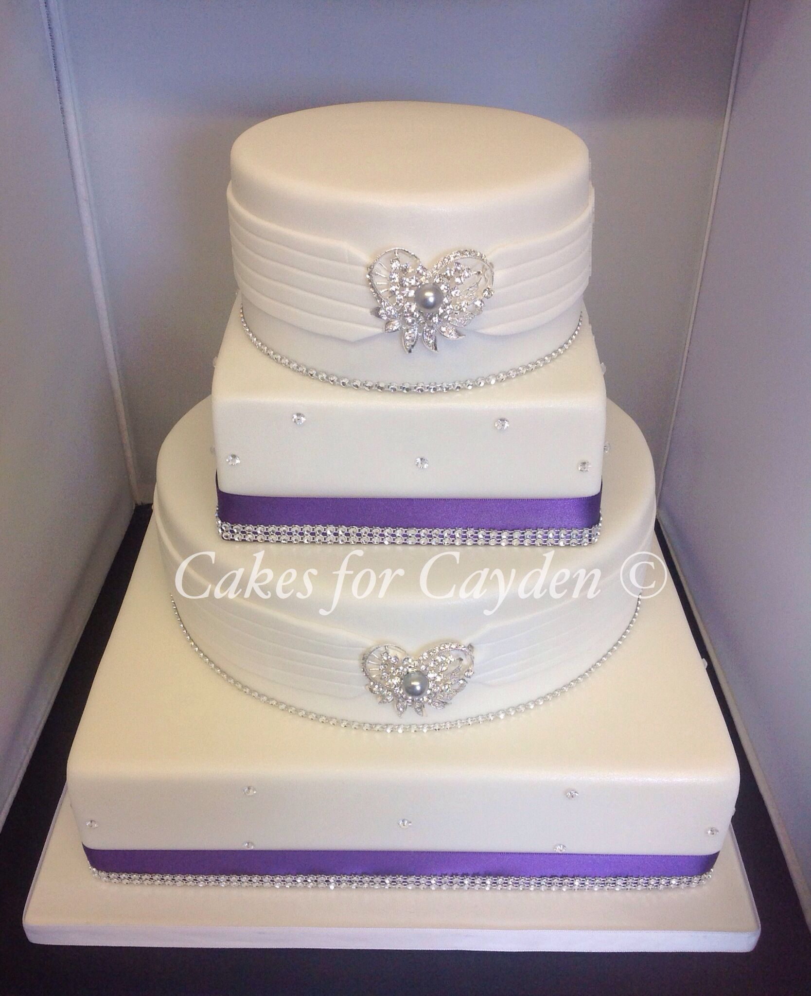 4 tier round and square wedding cake, purple and bling decor ...