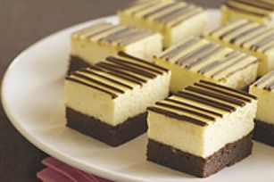 Brownie Bottom Cheesecake Bars - Have been making this recipie for years.  Add butterscotch chips to brownies and add carmel syrup to the top.  YUMMY!!!!