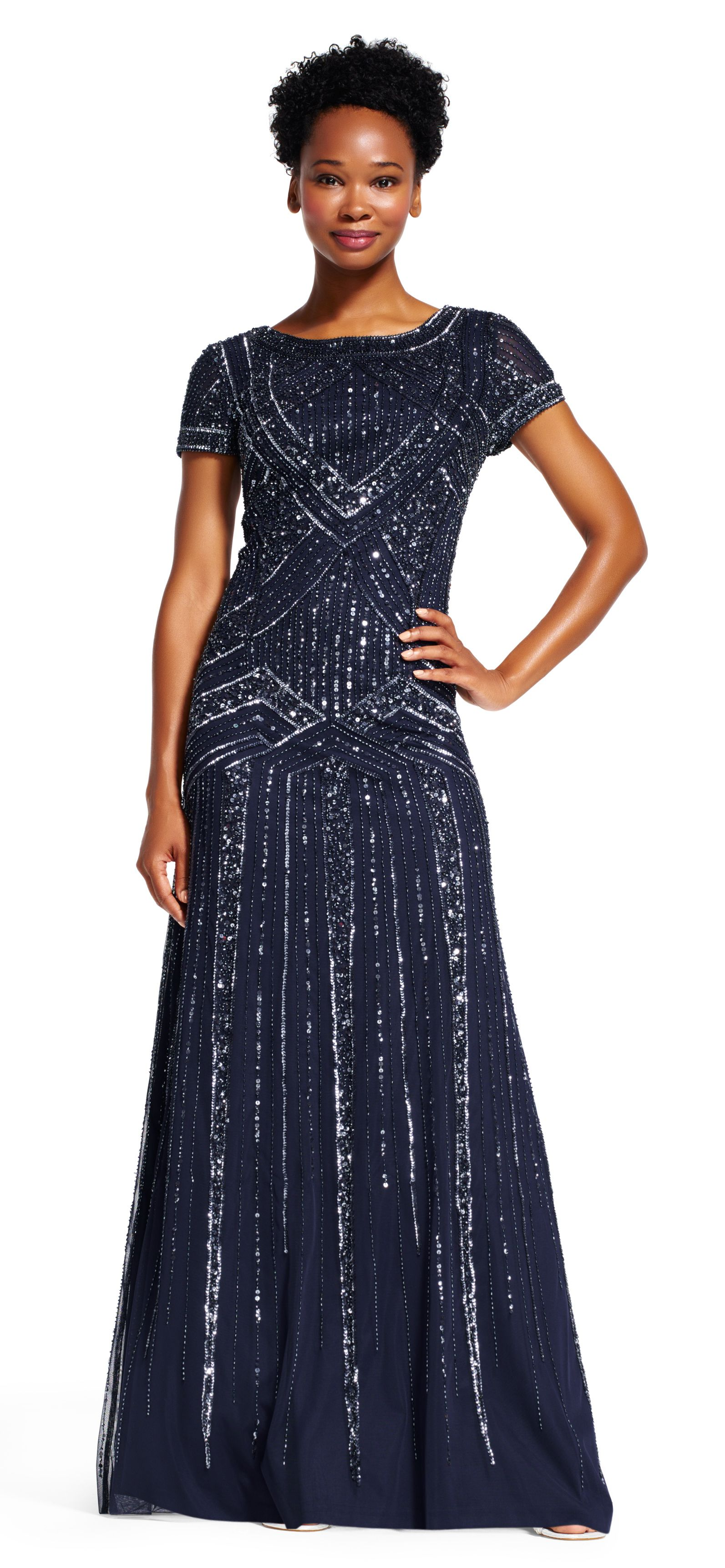 Sparkling details shine on this sophisticated evening gown this