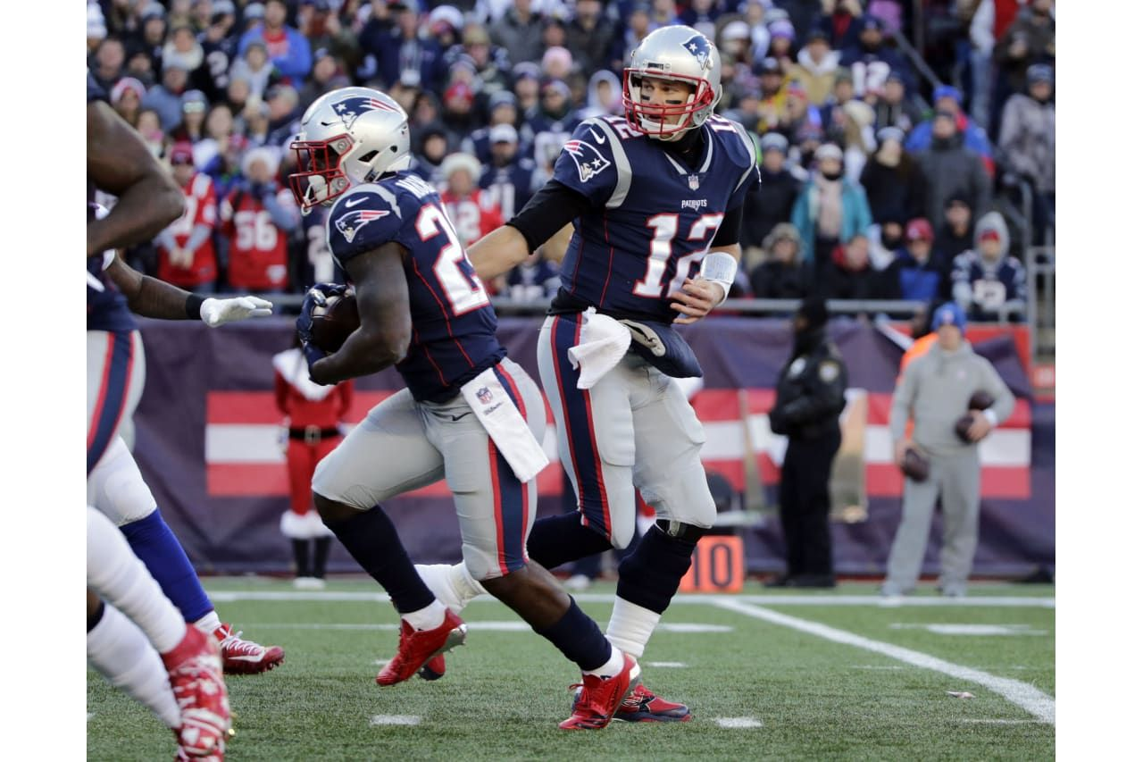 New England Patriots Quarterback Tom Brady Right Hands Off To Running Back Sony Michel During The First H New England Patriots Patriots Quarterbacks Patriots