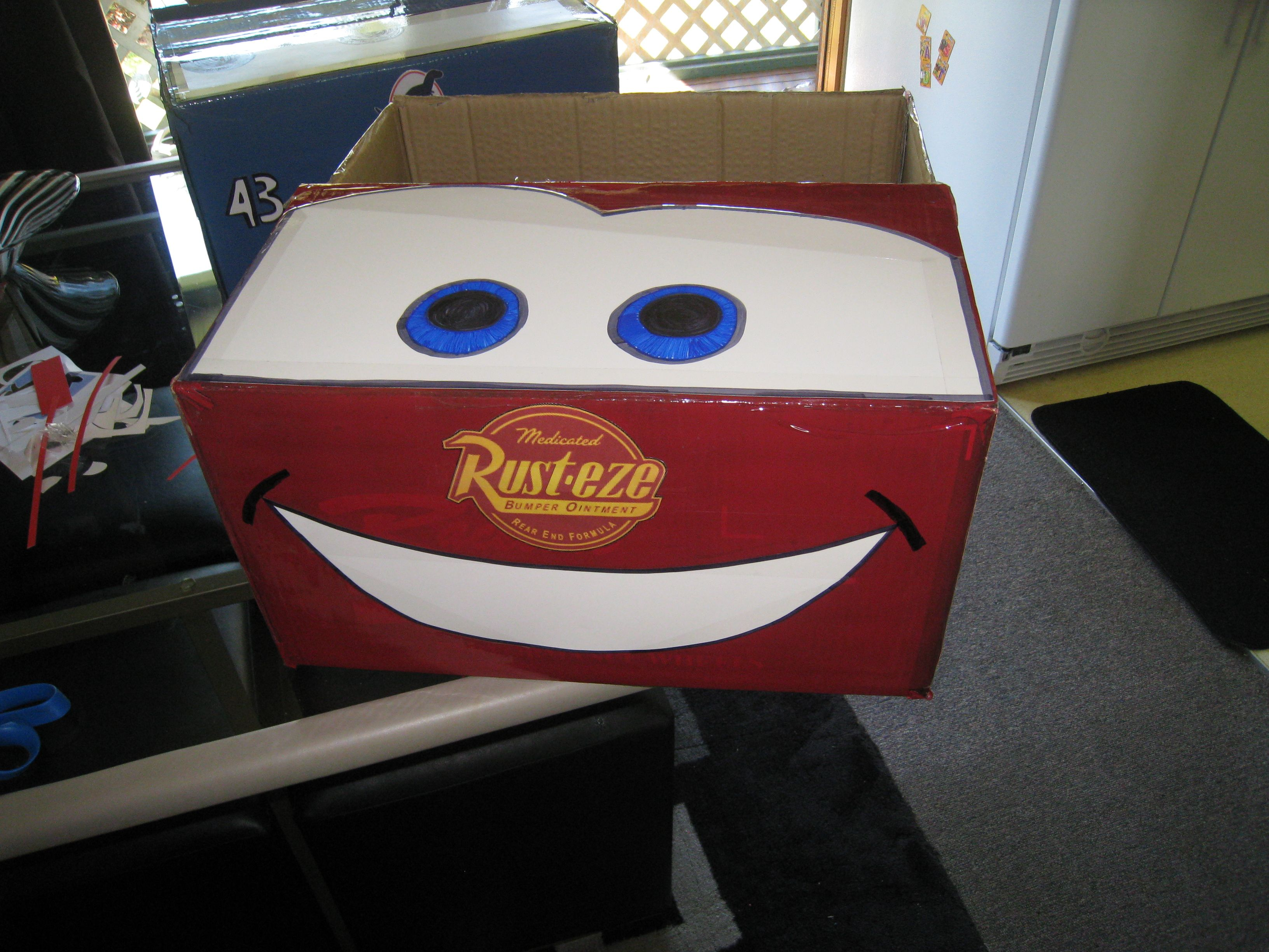 Lightning mcqueen cardboard box spray paint draw the face print out the logos
