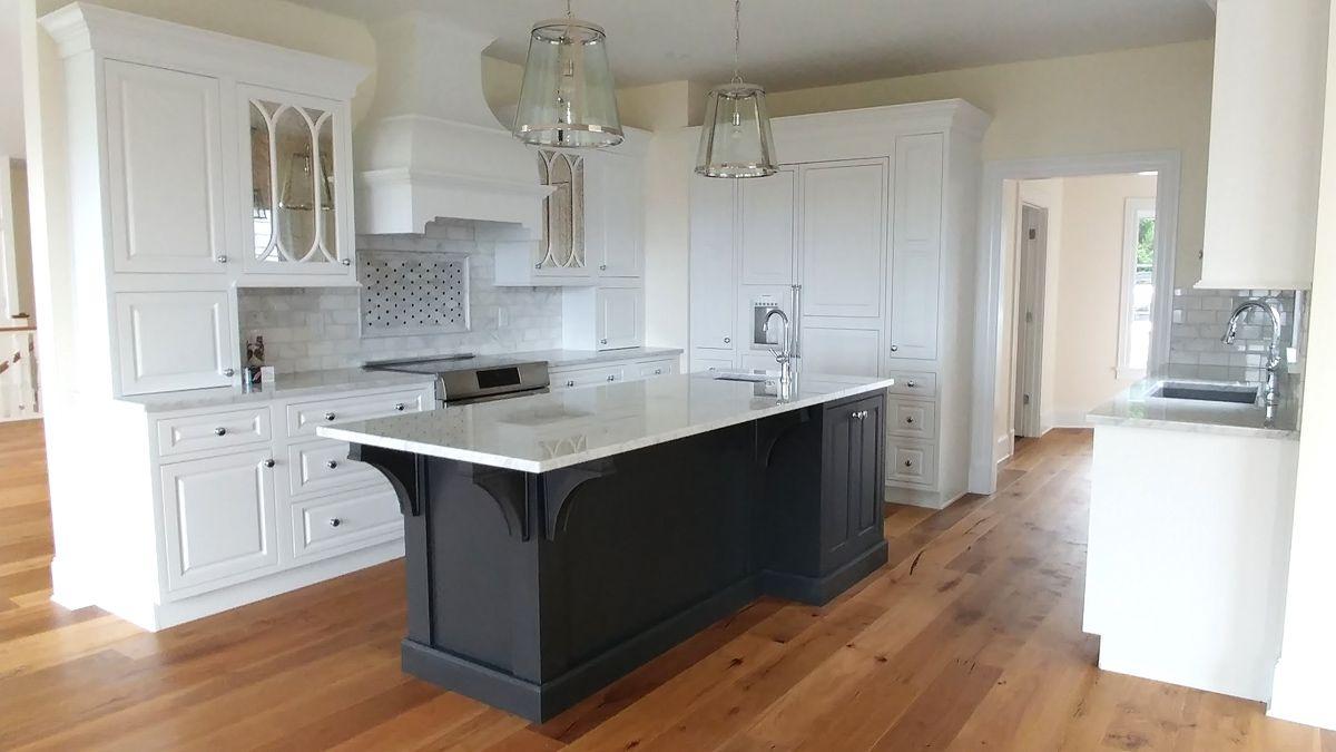 A Kitchen Remodel In Asheville North Carolina Was Designed With Starmark Cabinetry S Montico Inset Grey Kitchen Cabinets Kitchen Cabinet Design Cabinet Design