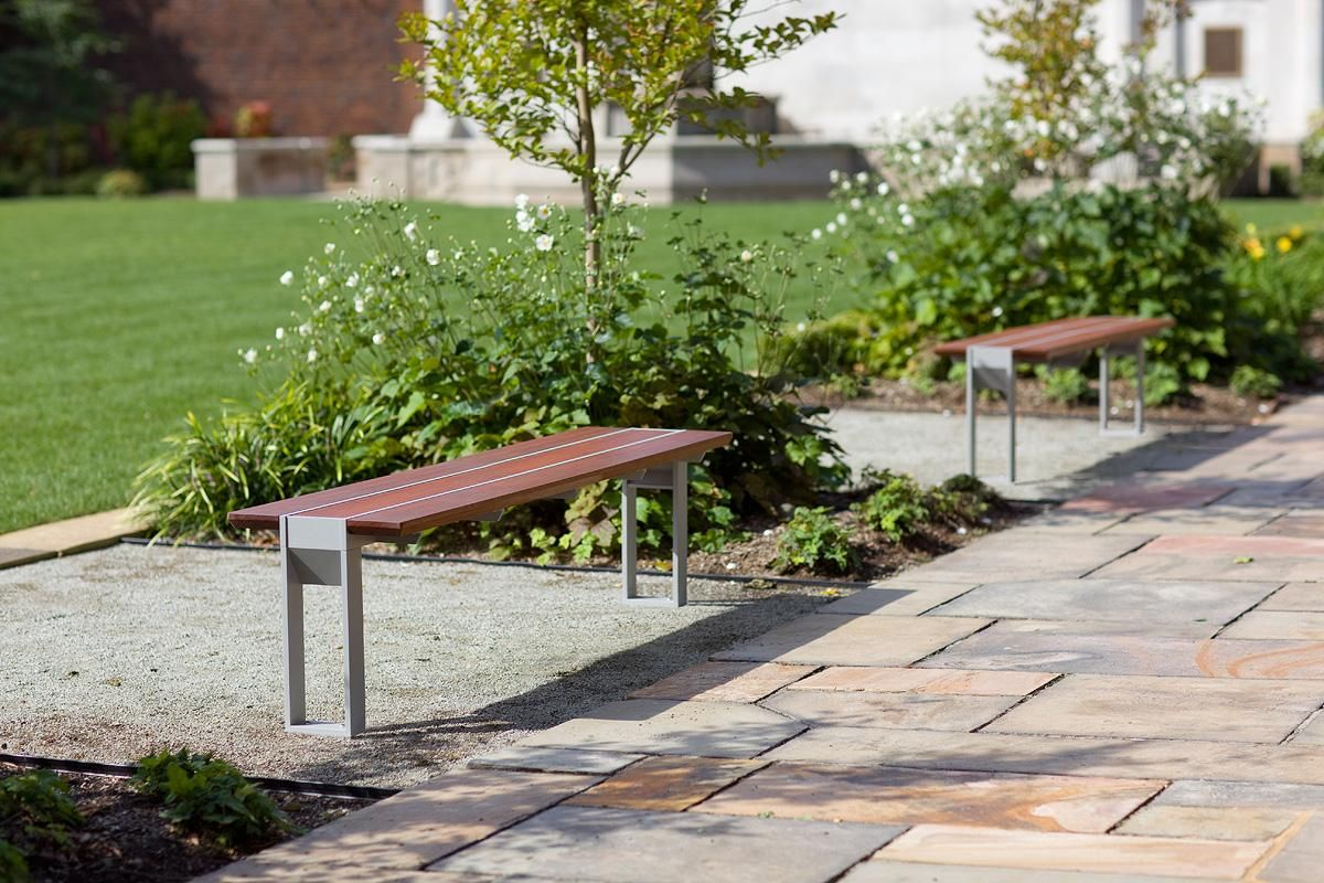 Apex Benches shown in standalone bench configuration with Aluminum Texture powdercoated frames and FSC® 100% Jatoba hardwood slats