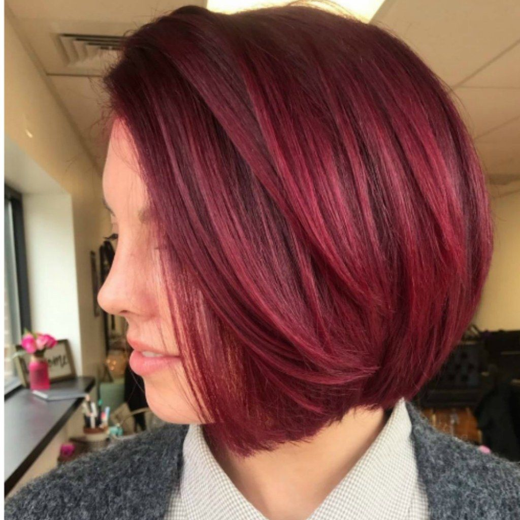 Cranberry Red Is The Sauciest Hair Color Trend Of The Holiday Season Winter Hair Color Trends Light Hair Color Winter Hair Color