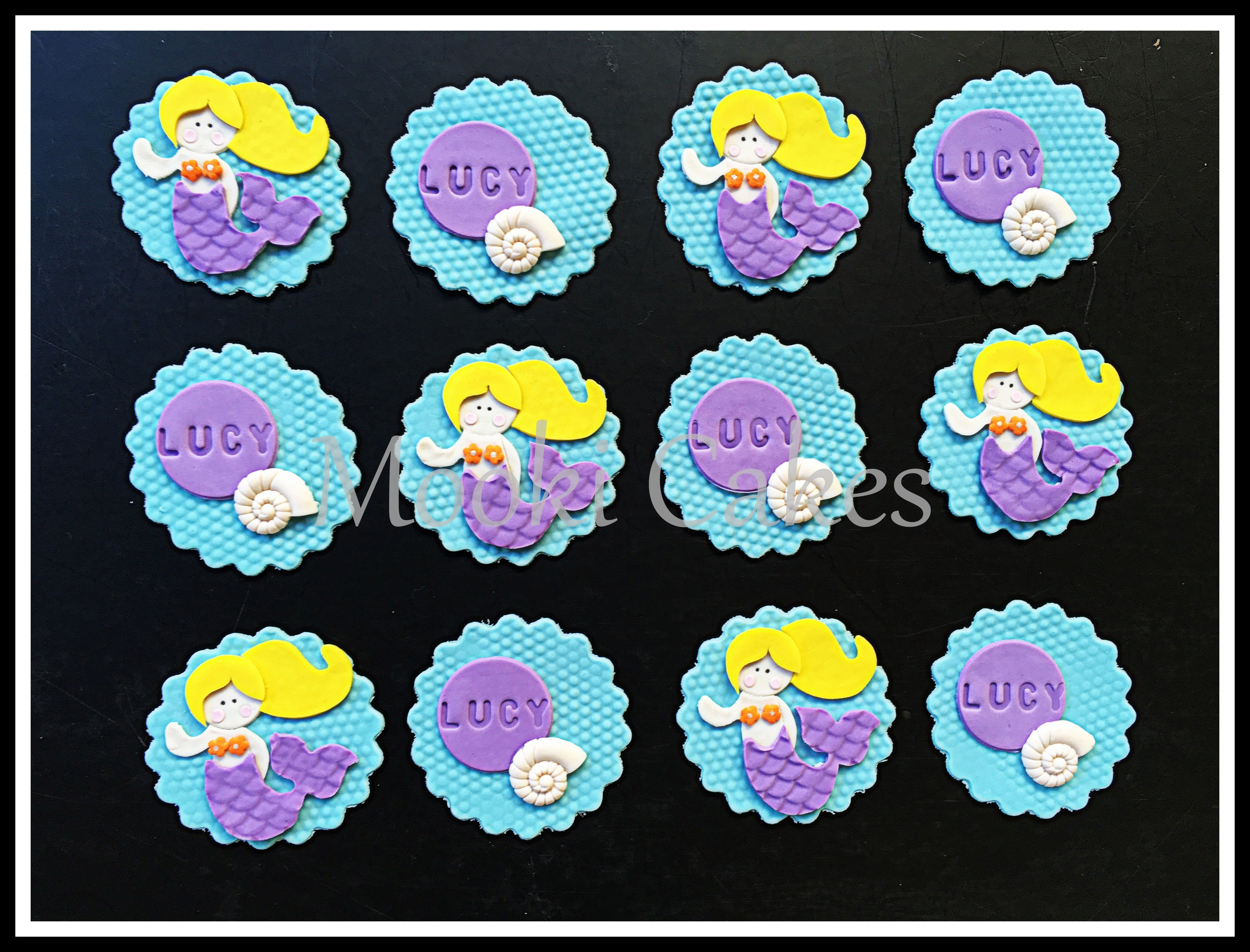 Mermaid-themed cupcake toppers.