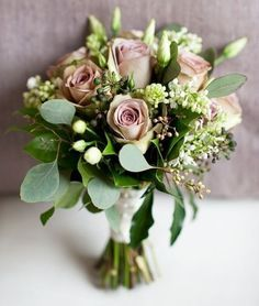 Beautiful bouquet featuring roses, eucalyptus..