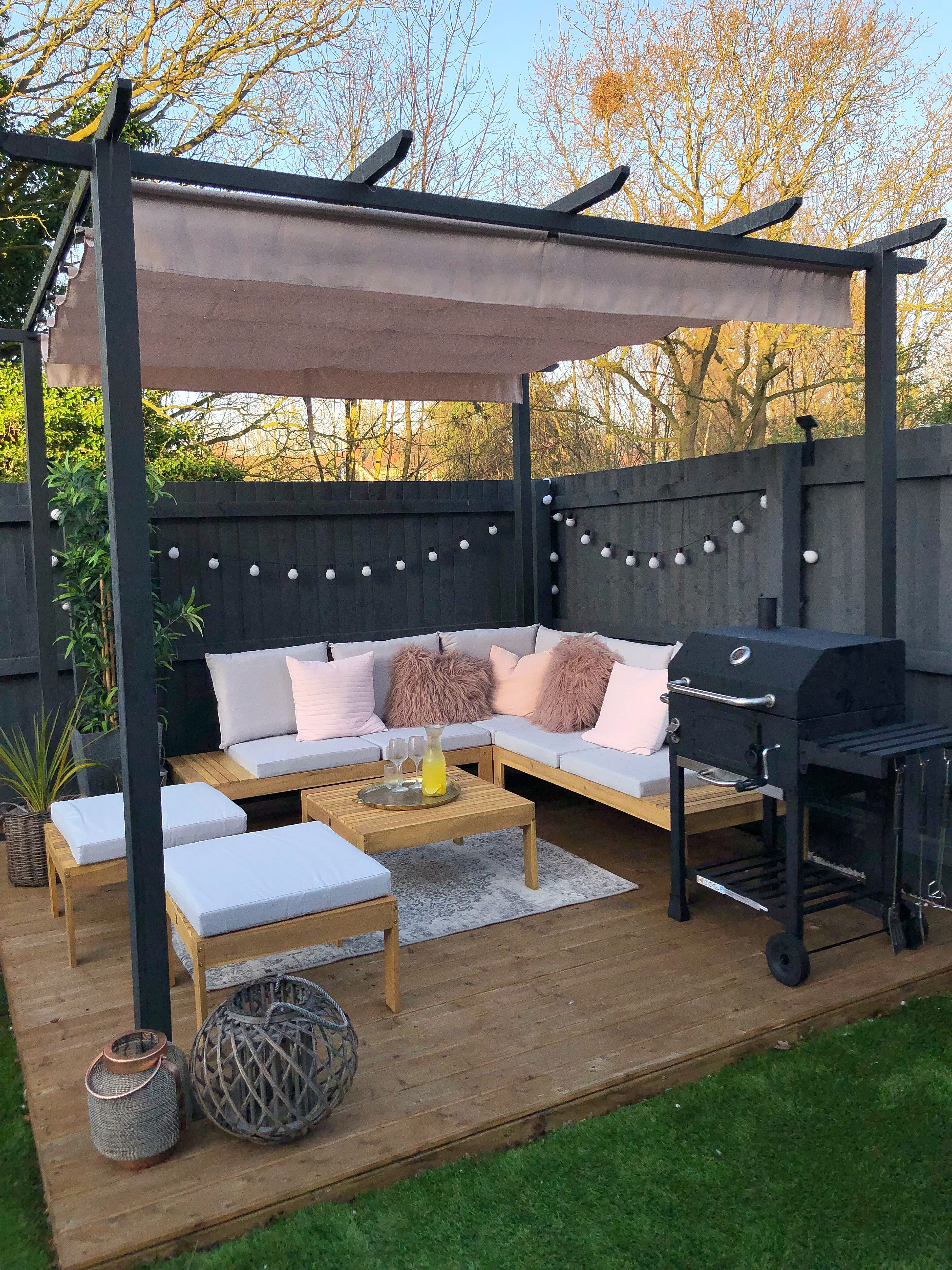 Decking with outdoor seating area corner sofa pergola and