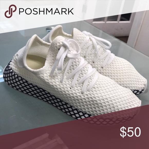 Adidas Sneakers Fishnet design, worn