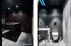 Nowoczesna piwnica z aneksem kuchennym oraz minimalistyczną łazienką