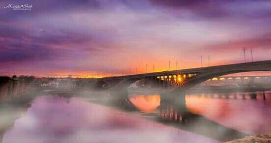 Sunset shines through the Royal Border Bridge