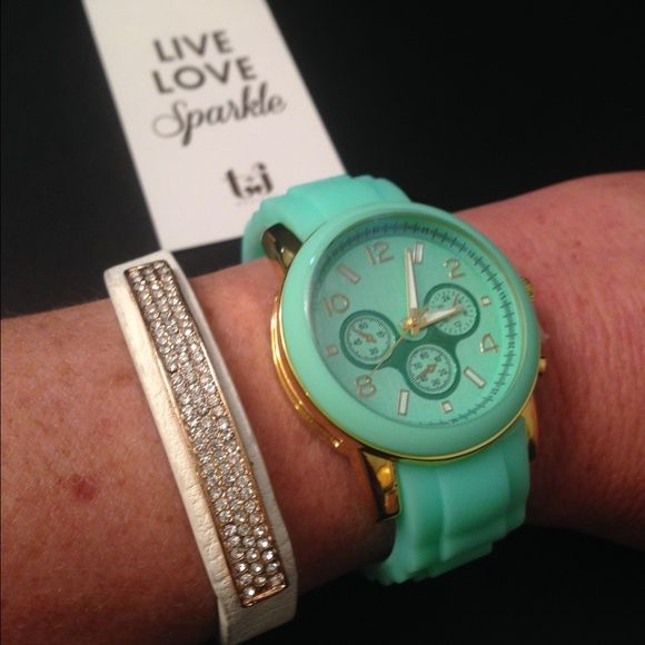"""NWT Mint Watch & White Leather Bracelet NWT. Perfect accessories for your spring/summer wardrobe.  A gorgeous rubber mint watch with gold accents.  Face 1.5"""" diameter.  Watchband .75"""" wide.  Approx 7"""" length with 1"""" extension.  Can be expanded from a 2"""" to 3"""" diameter.  Hook and loop buckle closure.  Includes a white vegan leather bracelet with gold and pave accents.  8.5"""" length can be adjusted for smaller wrists to 7.5"""" length.  Double snap closure.  TWO LEFT, please let me know if…"""