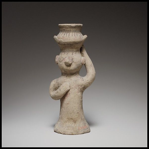 Standing female figurine holding an amphora on her head. Cypriot,  Cypro-Archaic I, ca. 750-600 B.C.