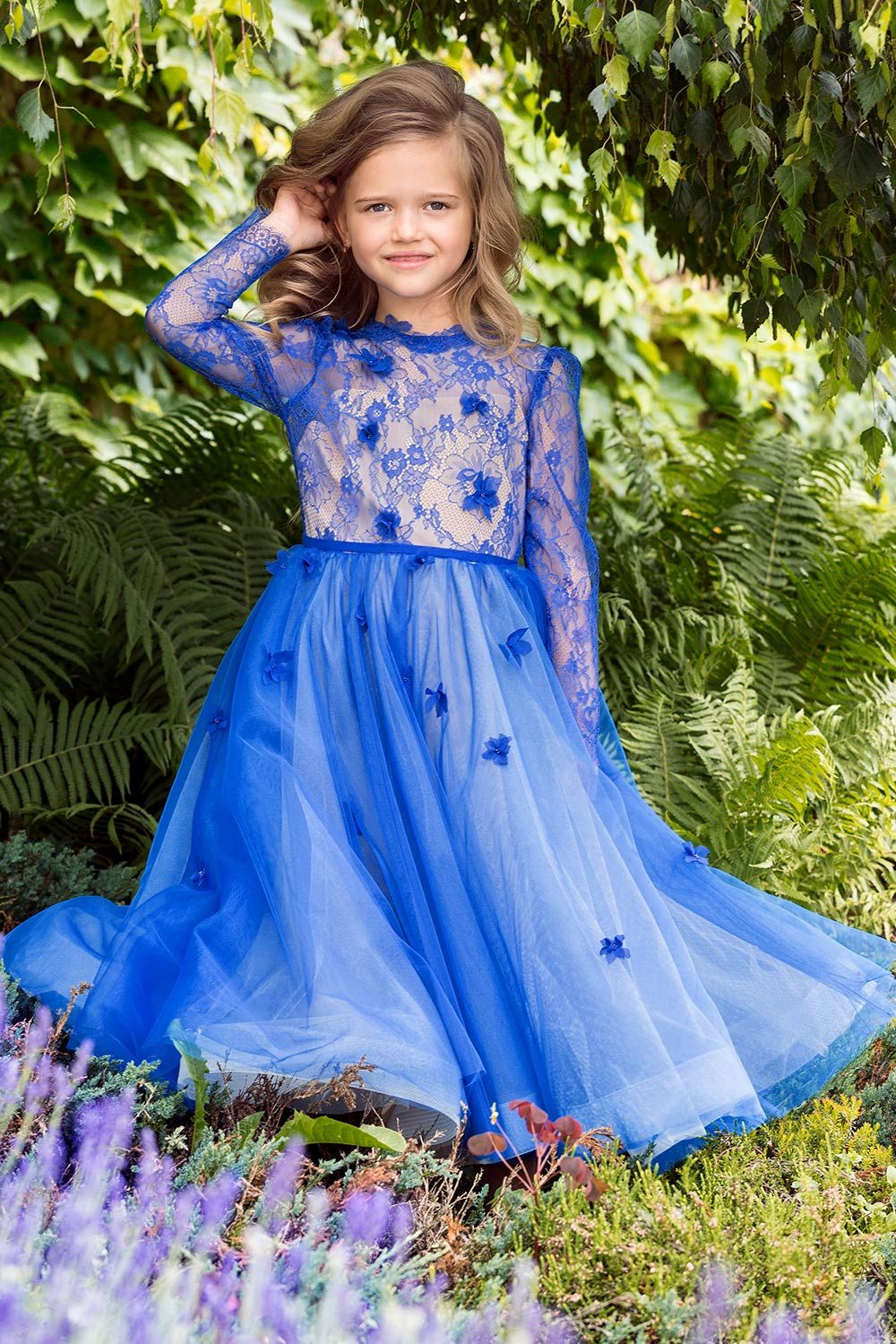 A bright royal blue flower girl dress with long sleeves