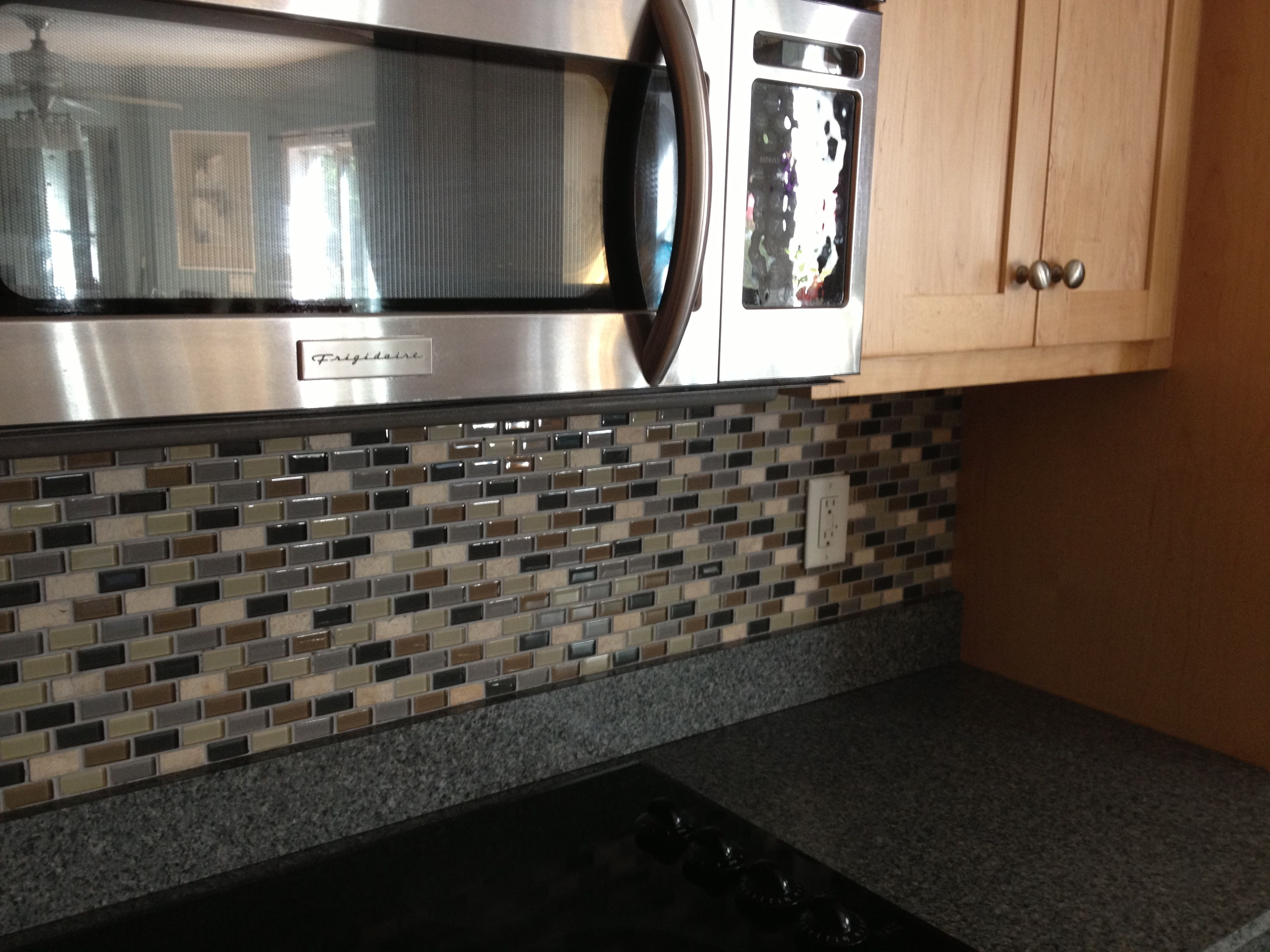 Glass and travertine mosaic tiles go up quickly and easily and can and easily and can be cut with a glass clipper under 15 at home depot instead of a tile saw place right over your existing laminate backsplash dailygadgetfo Image collections