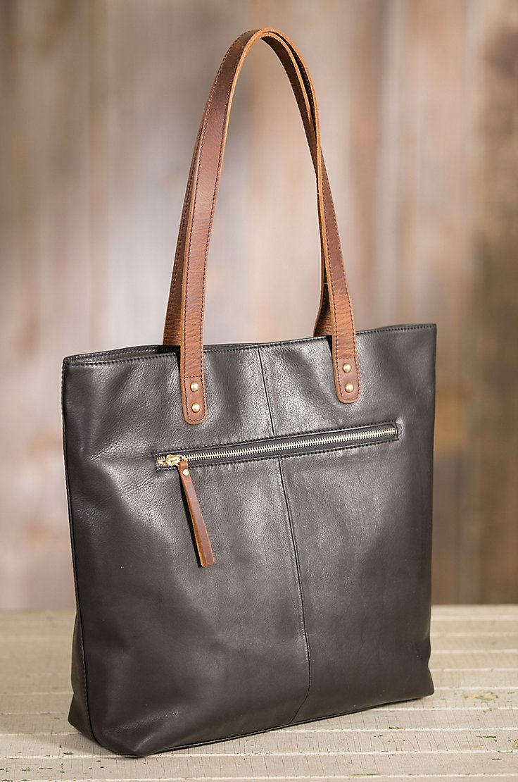 Premium Argentine cowhide leather with contrast leather handles give this  tote its fashion appeal. 841ef0b7adbc0
