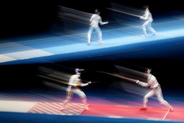 Injeong Choi of Korea (R) in action against Ana Maria Popescu (L) of Romania during the Women's Individual Epee: Quaterfinal on Day 1 of the Rio 2016 Olympic Games at Carioca Arena 3 on August 6, 2016 in Rio de Janeiro, Brazil. (Aug. 5, 2016 - Source: Ryan Pierse/Getty Images South America)