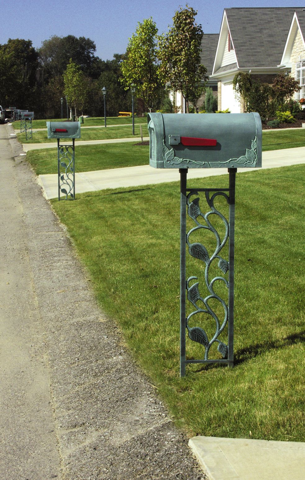 The floral cast aluminum mailbox post will add beauty to your home's curb appeal. #mailbox #mailboxes #beautification #decorative #landscape #homeowners #mailboxmonday #curbappeal #forsite #floral