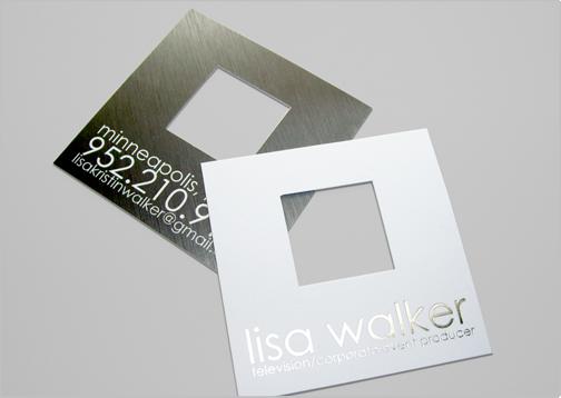 Cut Punch Out Business Card That Features Decorative Silver Foil