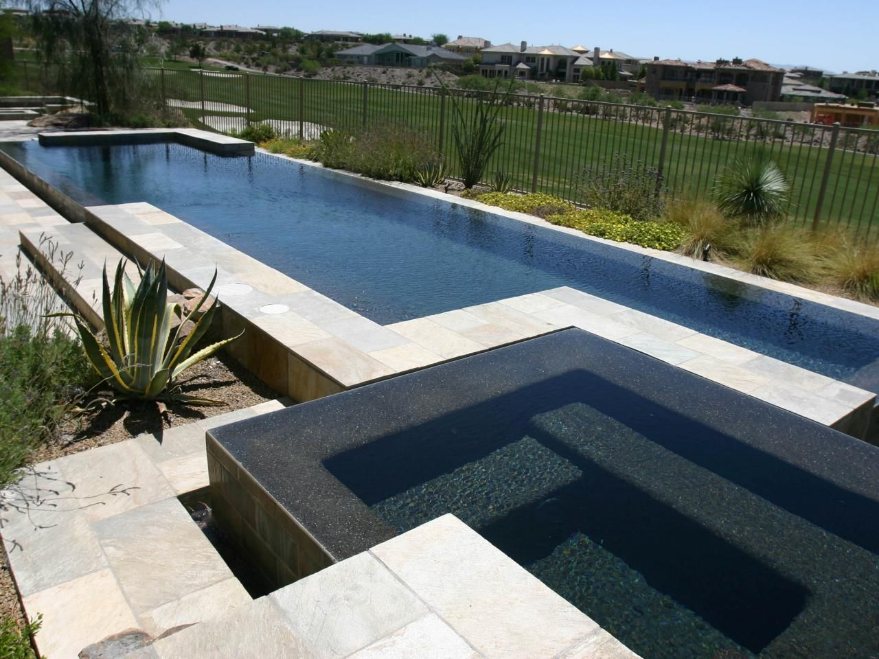 Modern pools with black river rock border google search for Modern swimming pool