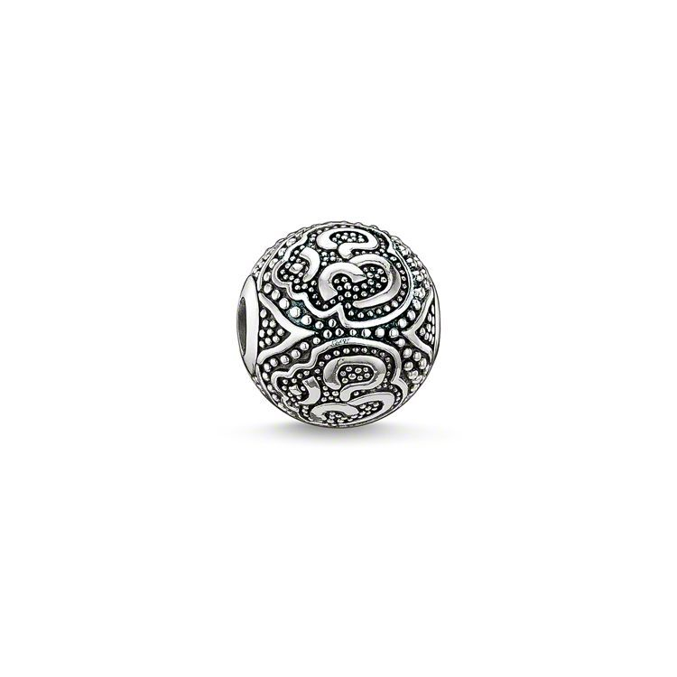 THOMAS SABO Karma Bead from the Sterling Silver Collection. om - 925 Sterling silver, blackened Size: ca. 1.1 cm THOMAS SABO has timelessly interpreted the 'Om' bead with applied knop details made of blackened silver. This artfully-finished bead is particularly beautiful when combined with coloured, faceted and matt-black stone beads.