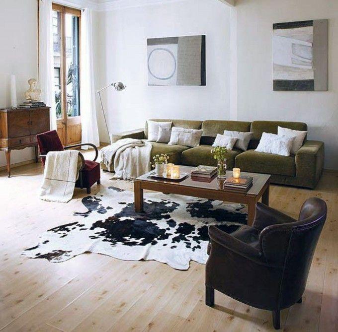 Living Room Faux Cowhide Rug For Retro Decor Plus Decorative Pillows On Tan Sofa